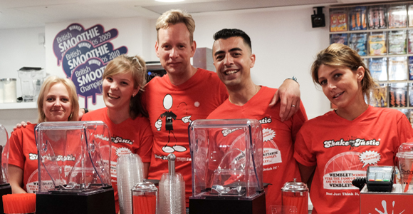 Josh Kettle (centre left) and Amir Darabi at the opening of its store in Wembley, London.