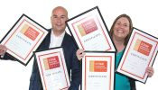Ian Christelow and Julie Wagstaff, ActionCOACH's UK Recruitment Director,            celebrate five years of 5 Star Franchisee Satisfaction.