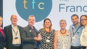 The Franchising Centre (TFC) receiving their award. From left: Pip Wilkins, members of the TFC team (Brian Duckett, Alan Wilkinson, Laura Harvey-Smith, Shirley Hughes, Dugan Aylen) and Emily Price (BFA).